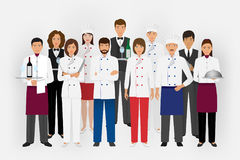 Hotel restaurant team concept in uniform. Group of catering characters standing together chef, cook, waiters and barman. Stock Photo