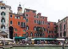 Hotel Rialto. Venice,Italy- July 30, 2011:People walking in front of Rialto Hotel near the Grand Canal in Venice Stock Image