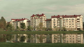 Hotel on the river. Autumn daytime. Smooth dolly shot.  stock footage