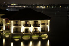 Hotel and river at night Royalty Free Stock Images
