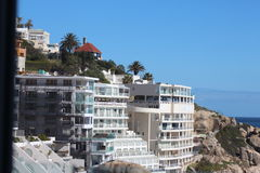 Hotel on the Rocks. A Beautiful  picturesque view of the hotel surrounded by rocks and the  turquoise ocean in Cape Town Royalty Free Stock Photography
