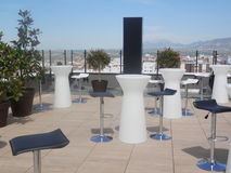 Hotel rooftop bar. Stylish chairs and tables in rooftop hotel bar in Jaen, Andalusia royalty free stock photo