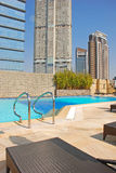 Hotel Rooftop Swimming Pool with Deckchair Royalty Free Stock Images