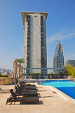 Hotel Rooftop Swimming Pool with deckchair. Hotel Rooftop Swimming Pool in Tsim Sha Tsui Area Southern Kowloon Hong Kong Stock Photography