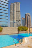 Hotel Rooftop Swimming Pool with Office Buildings Stock Photos