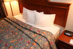 Hotel Room 10. Side view of bed and night stand royalty free stock photos
