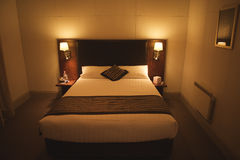 Hotel room. Modern interior with King size bed in a hotel room at night Royalty Free Stock Photography