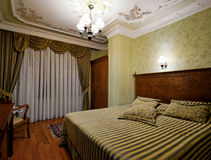 Hotel Room. Comfortable hotel room offering lodging and comforts to travelers Royalty Free Stock Photos