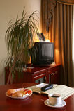 Hotel Room. A comfortable hotel room with a light continental breakfast including coffee and business book on a table stock images