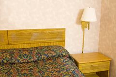 Hotel room. Showing the bed night stand and lamp royalty free stock photo