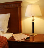 Hotel room. Interior of hotel room with lamp and newspaper royalty free stock photos