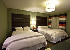 Hotel room. Interior of hotel room with two beds stock photos