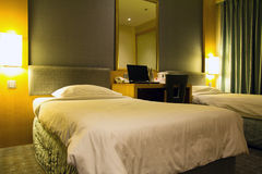 Hotel room. Interior of a modern luxury hotel room with two single beds Royalty Free Stock Photos