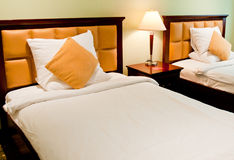 Hotel Room. Luxurious room in a hotel or apartment with twin beds, may be used as a banner Royalty Free Stock Photos