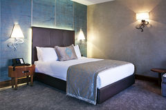 Hotel Room. Interior of a modern luxury hotel room Royalty Free Stock Photos