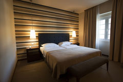 Hotel Room. With lights on and brown decoration Stock Images