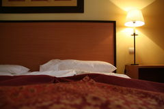 Hotel Room. Light and bed details Stock Photos