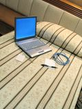Hotel room - 4. Hotel bed with notebook, keys, network cable and notepad, depicting a business traveller's life stock photography