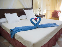 Hotel room. Swans made of towels on a hotel bed Royalty Free Stock Photography