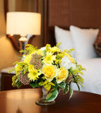 Hotel room arrangment. Hotel room arranged with yellow flowers Stock Image