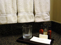 Hotel Room Bathroom. This is a close up image of the amenties and towels in a hotel room bathroom stock photo