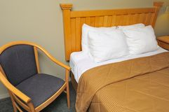 Hotel room with bed and chair Royalty Free Stock Images