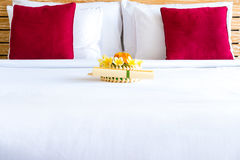 Hotel room with bed and flower arrangement Royalty Free Stock Photos