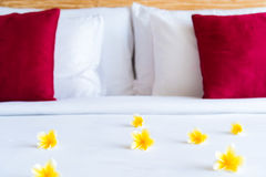 Hotel room with bed and flower arrangement Stock Photography