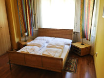 Hotel room bed. Large bed near window in hotel room Royalty Free Stock Photography