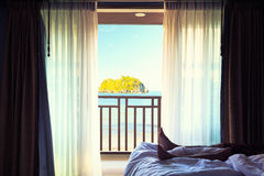 Hotel room with bed and view in a beautiful blue sky and in the Royalty Free Stock Photo