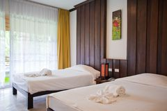 Hotel room with bed and wooden Royalty Free Stock Images