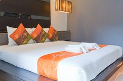 Hotel room with bed and wooden Stock Images
