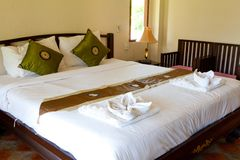 Hotel room with bed and wooden Stock Photo