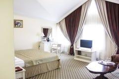 Hotel room in calm colours, sitting area, retro style Stock Photo