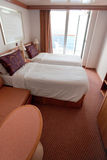 Hotel room on cruise liner - two bed room Royalty Free Stock Photos