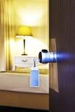 Hotel room door. Key hanging on the door of the hotel royalty free stock image
