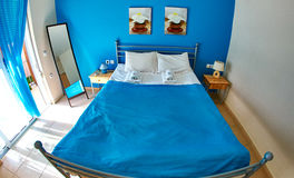 Hotel room with double bed. Hotel room in blue color with double bed. Vacation on Crete, Greece Stock Photos