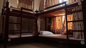 Hotel room with empty bunk beds in a small room of the Asian hostel in Vietnam. stock video