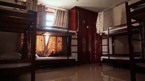 Hotel room with empty bunk beds in a small room of the Asian hostel, Vietnam. stock footage
