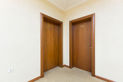 Hotel room entrance - two brown wooden doors Royalty Free Stock Photography