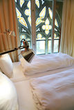 Hotel room with gothic window Royalty Free Stock Images