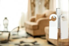 Hotel room with handle sign on the door Royalty Free Stock Image