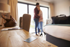 Hotel Room Key With Romantic Couple In Background Royalty Free Stock Image