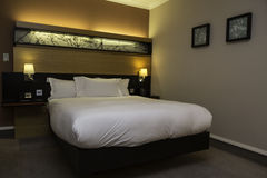 King size bed. In a hotel room Royalty Free Stock Photo