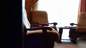 Hotel room luxury and superior. Suite room at the hotel. The room sofa, bed, table, chairs, TV, balcony. The house is made of wood stock video footage