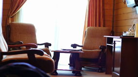 Hotel room luxury and superior. Suite room at the hotel. The room sofa, bed, table, chairs, TV, balcony. The house is made of wood stock video