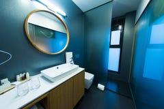 Hotel room with  modern bathroom Stock Photos