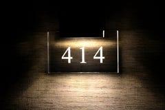 Hotel Room Number. Illuminated hotel room number 414 Stock Image