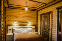 A hotel room or a private home decorated with a tree decorated rustic Stock Images