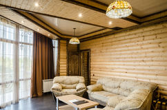 A hotel room or a private home decorated with a tree decorated rustic Royalty Free Stock Image